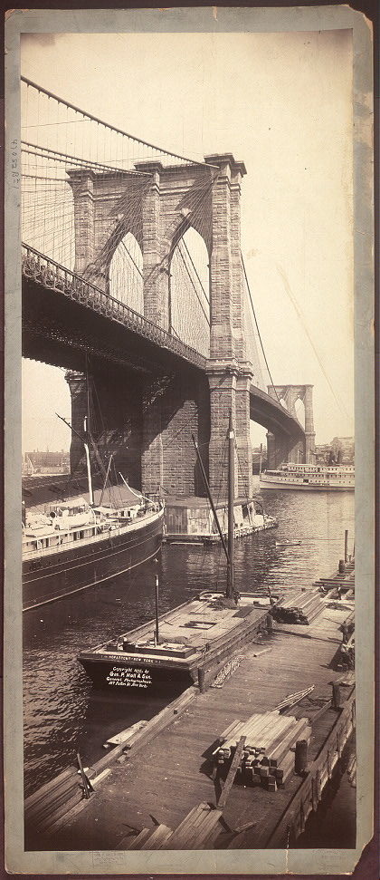 A black-and-white photograph of the Brooklyn Bridge